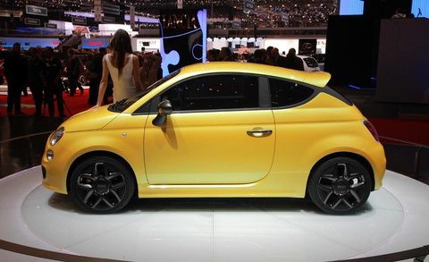 Motor vehicle, Wheel, Automotive design, Yellow, Vehicle, Car, Auto show, Exhibition, Hatchback, City car,