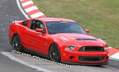 Automotive design, Vehicle, Hood, Infrastructure, Red, Automotive tire, Rim, Performance car, Grille, Car,