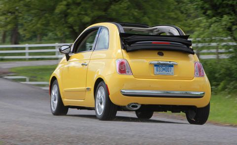 Motor vehicle, Tire, Wheel, Automotive design, Vehicle, Yellow, Road, Car, Road surface, Rim,