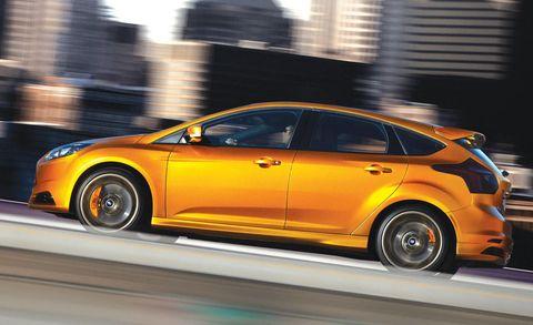 Wheel, Tire, Automotive design, Yellow, Vehicle, Car, Fender, Rim, Alloy wheel, Automotive tire,