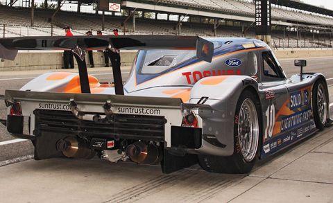Automotive design, Mode of transport, Automotive exterior, Logo, Race car, Rim, Motorsport, Sports car, Auto part, Touring car racing,