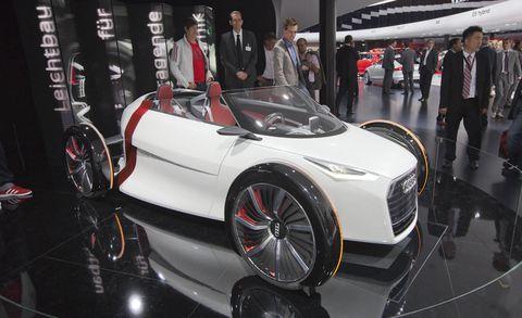 Tire, Wheel, Automotive design, Vehicle, Event, Land vehicle, Car, Auto show, Exhibition, Personal luxury car,