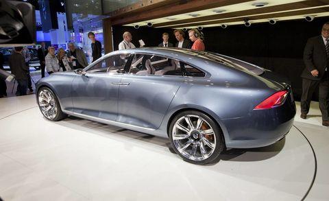 Tire, Wheel, Automotive design, Vehicle, Land vehicle, Car, Auto show, Personal luxury car, Exhibition, Alloy wheel,