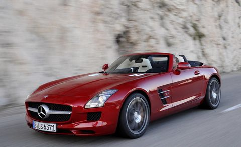 Tire, Automotive design, Vehicle, Land vehicle, Hood, Red, Car, Performance car, Automotive mirror, Automotive tire,