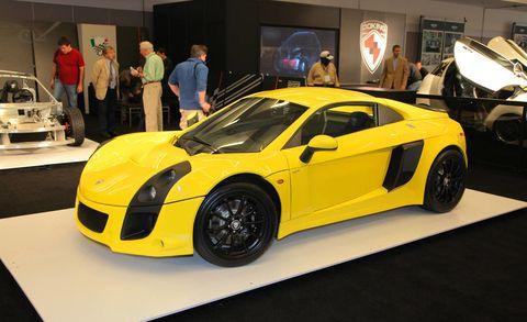 Tire, Motor vehicle, Wheel, Automotive design, Mode of transport, Vehicle, Yellow, Land vehicle, Performance car, Car,