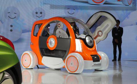 Automotive design, Orange, Cartoon, Automotive wheel system, Machine, Rolling, Circle, Graphics, Synthetic rubber, Animation,