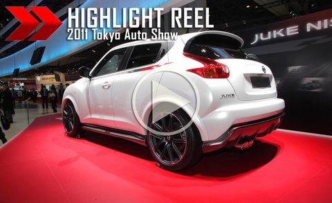 Automotive design, Vehicle, Land vehicle, Car, Hatchback, Logo, Auto show, Exhibition, Bumper, Brand,
