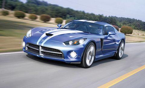 Tire, Automotive design, Blue, Daytime, Road, Vehicle, Headlamp, Hood, Automotive lighting, Performance car,