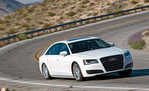 Tire, Wheel, Automotive design, Vehicle, Road, Land vehicle, Automotive mirror, Car, Grille, Automotive parking light,