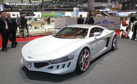 Wheel, Tire, Mode of transport, Automotive design, Land vehicle, Vehicle, Event, Car, Personal luxury car, Fender,