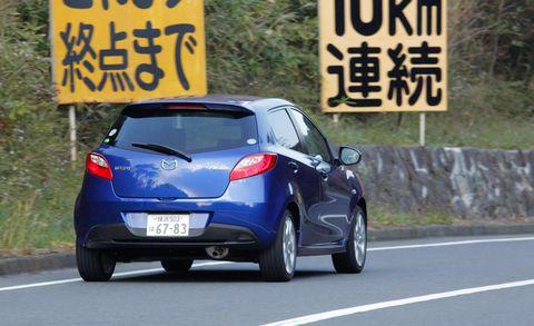 Motor vehicle, Wheel, Mode of transport, Automotive design, Road, Vehicle, Car, Road surface, Asphalt, Hatchback,