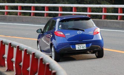Automotive design, Mode of transport, Vehicle, Car, Hatchback, Asphalt, Rear-view mirror, Automotive mirror, Guard rail, Majorelle blue,
