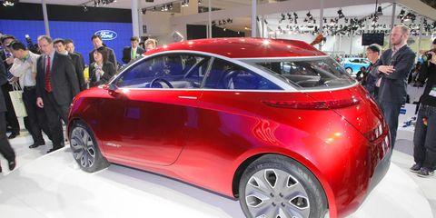 Automotive design, Vehicle, Land vehicle, Event, Car, Auto show, Exhibition, Personal luxury car, Luxury vehicle, Car dealership,