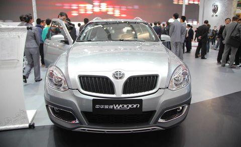 Motor vehicle, Automotive design, Vehicle, Land vehicle, Event, Grille, Car, Vehicle registration plate, Personal luxury car, Automotive lighting,