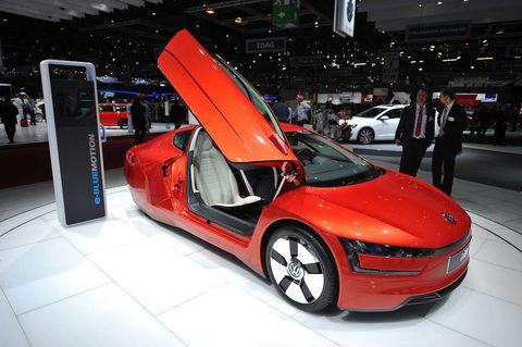 Tire, Automotive design, Vehicle, Event, Land vehicle, Car, Personal luxury car, Automotive mirror, Concept car, Auto show,