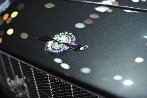Automotive design, Grille, Logo, Classic, Hood, Luxury vehicle, Symbol, Design, Classic car, Circle,