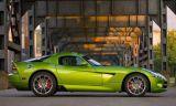 Motor vehicle, Tire, Mode of transport, Automotive design, Automotive tire, Transport, Green, Yellow, Property, Hood,