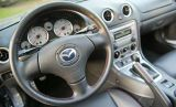 Motor vehicle, Mode of transport, Product, Transport, Steering part, Photograph, White, Steering wheel, Technology, Auto part,