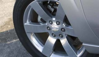 Wheel, Tire, Alloy wheel, Automotive tire, Automotive wheel system, Spoke, Rim, Photograph, White, Synthetic rubber,