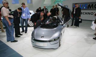 Motor vehicle, Mode of transport, Automotive design, People, Event, Transport, Floor, Automotive exterior, Automotive mirror, Grille,
