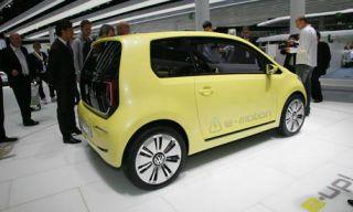 Clothing, Motor vehicle, Tire, Wheel, Mode of transport, Automotive design, Yellow, Vehicle, Alloy wheel, Car,