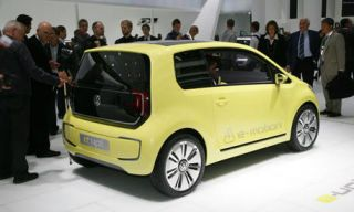 Motor vehicle, Automotive design, Mode of transport, Yellow, Vehicle, Car, Alloy wheel, Hatchback, Rim, Automotive wheel system,