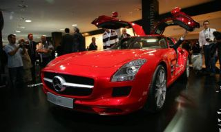 Mode of transport, Automotive design, Vehicle, Event, Red, Photograph, Car, Automotive lighting, Grille, Sports car,