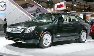Tire, Motor vehicle, Wheel, Mode of transport, Automotive design, Transport, Vehicle, Land vehicle, Car, Rim,