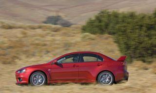 Tire, Wheel, Automotive design, Vehicle, Land vehicle, Automotive mirror, Alloy wheel, Car, Red, Rim,