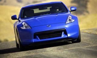 Automotive design, Blue, Mode of transport, Vehicle, Hood, Transport, Car, Automotive mirror, Photograph, Performance car,
