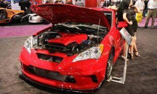Automotive design, Vehicle, Event, Land vehicle, Car, Red, Hood, Fender, Bumper, Automotive lighting,