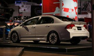 Tire, Mode of transport, Automotive design, Automotive tail & brake light, Alloy wheel, Car, Full-size car, Rim, Mid-size car, Sedan,