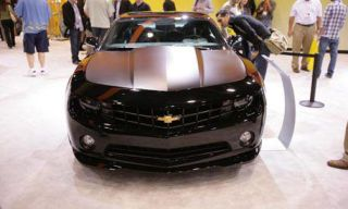Motor vehicle, Automotive design, Vehicle, Event, Grille, Transport, Car, Headlamp, Hood, White,