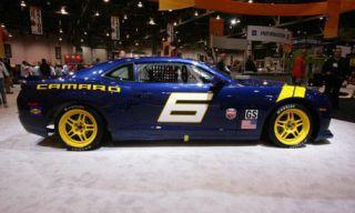 Tire, Wheel, Motor vehicle, Automotive design, Blue, Vehicle, Yellow, Automotive tire, Land vehicle, Transport,