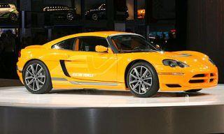Mode of transport, Automotive design, Vehicle, Yellow, Hood, Car, Vehicle door, Performance car, Automotive mirror, Rim,