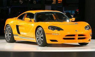 Tire, Mode of transport, Automotive design, Yellow, Vehicle, Car, Automotive lighting, Rim, Automotive mirror, Red,