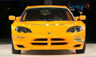 Mode of transport, Automotive design, Vehicle, Yellow, Hood, Transport, Grille, Headlamp, Car, Automotive mirror,