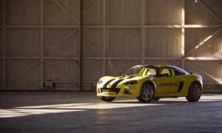 Tire, Yellow, Automotive design, Motorsport, Car, Performance car, Rim, Automotive exterior, Fender, Automotive lighting,