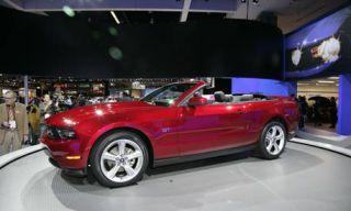Tire, Automotive design, Vehicle, Hood, Alloy wheel, Car, Red, Fender, Automotive lighting, Rim,