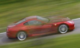 Tire, Wheel, Mode of transport, Automotive design, Vehicle, Car, Automotive tire, Red, Automotive wheel system, Performance car,