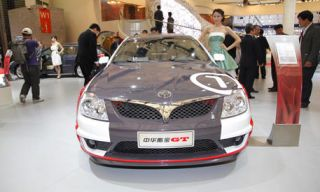 Clothing, Motor vehicle, Mode of transport, Automotive design, Event, Vehicle, Photograph, Car, Grille, Personal luxury car,