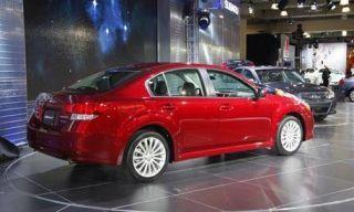 Tire, Wheel, Mode of transport, Automotive design, Vehicle, Land vehicle, Alloy wheel, Car, Rim, Red,