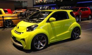 Wheel, Tire, Motor vehicle, Mode of transport, Automotive design, Vehicle, Yellow, Land vehicle, Automotive wheel system, Car,