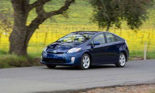 Tire, Motor vehicle, Wheel, Automotive mirror, Mode of transport, Nature, Automotive design, Road, Vehicle, Yellow,
