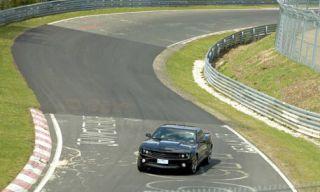 Road, Motor vehicle, Mode of transport, Automotive design, Grass, Green, Road surface, Asphalt, Race track, Automotive tire,
