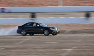 Mode of transport, Vehicle, Automotive design, Land vehicle, Motorsport, Car, Automotive mirror, Asphalt, Race track, Mid-size car,