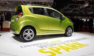 Tire, Motor vehicle, Wheel, Mode of transport, Automotive design, Yellow, Vehicle, Transport, Alloy wheel, Car,