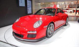 Automotive design, Vehicle, Car, Red, Alloy wheel, Automotive lighting, Fender, Rim, Bumper, Sports car,