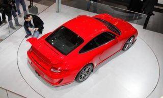Automotive design, Mode of transport, Vehicle, Land vehicle, Car, Floor, Alloy wheel, Automotive tail & brake light, Red, Rim,