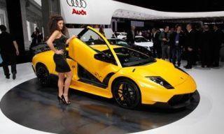Clothing, Motor vehicle, Tire, Mode of transport, Automotive design, Transport, Yellow, Vehicle, Land vehicle, Car,